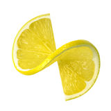 Fatia da torção do limão isolada no fundo branco foto de stock