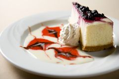 Fatia de bolo de queijo Fotos de Stock