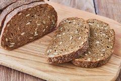 Fatia de pão de centeio com sementes Fotos de Stock Royalty Free