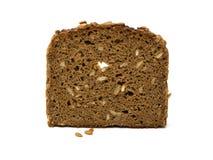 Fatia de pão marrom da grão inteira Foto de Stock Royalty Free