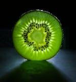 Fatia do fruto de quivi Imagem de Stock Royalty Free