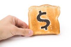 Fatia do pão com sinal de dólar imagem de stock royalty free
