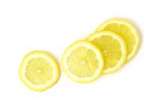 Fatia fresca do fruto do limão do close up no fundo branco, foco seletivo Fotografia de Stock Royalty Free