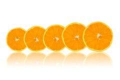 Fatias alaranjadas da fruta Fotos de Stock