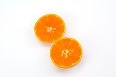 Fatias alaranjadas do fruto Fotografia de Stock