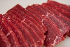 Fatias cruas de carne Imagens de Stock