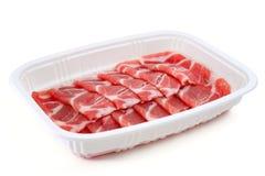 Fatias cruas do bacon Imagens de Stock