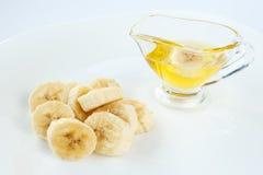 Fatias da banana com mel Fotos de Stock Royalty Free