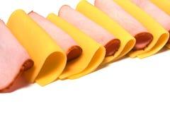 Fatias da carne e do queijo isoladas no branco Foto de Stock Royalty Free