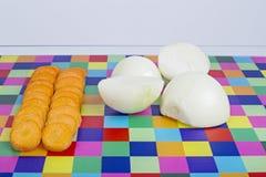 Fatias da cenoura e da cebola Imagens de Stock