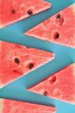 Fatias da melancia no fundo azul fotografia de stock royalty free