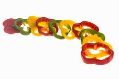 Fatias da pimenta isoladas Imagem de Stock