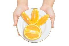 Fatias de oferecimento de laranjas Foto de Stock