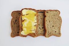 Fatias de pão com manteiga e mel Fotografia de Stock Royalty Free