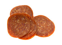 Fatias de pepperoni no fundo branco imagens de stock royalty free