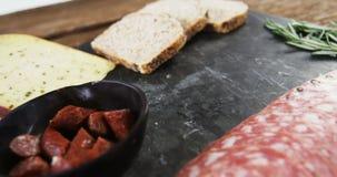 Fatias de presunto, de pão e de queijo filme