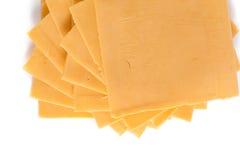 Fatias de queijo cheddar Imagens de Stock Royalty Free