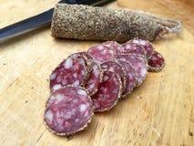Fatias de salame com pimenta Fotografia de Stock