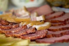 Fatias de salsicha, de presunto e de queijo Imagens de Stock Royalty Free