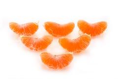 Fatias de um tangerine Foto de Stock Royalty Free