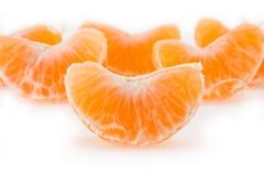 Fatias de um tangerine Fotos de Stock Royalty Free