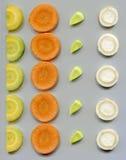 Fatias de vegetais de raiz Imagens de Stock