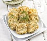 Fatias do abobrinha no tempura imagens de stock royalty free