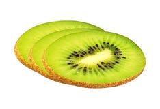 Fatias do fruto de quivi isoladas no branco imagem de stock