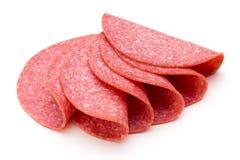 Fatias do salame isoladas no fundo branco Imagens de Stock Royalty Free