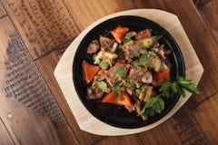 Fatias fritadas da carne do cordeiro Fotografia de Stock