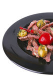 Fatias seridas da carne no prato Imagens de Stock