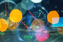 Fatigue of the driver on the night highway. Conceptual speedometer Stock Photos