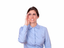 Fatigue hispanic lady standing with headache Stock Image