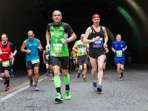 The fatigue of the marathon athlete Royalty Free Stock Photos