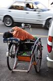 FATIGUE. TAXI BIKE Royalty Free Stock Image
