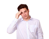 Fatigue young man with headache standing Royalty Free Stock Images
