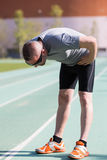 Fatigued athlete. Sportsman fatigued after seeing traveled a long distance stock images