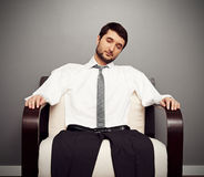 Fatigued businessman on the armchair. Concept photo of fatigued businessman on the armchair stock photo