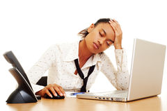 Fatigued businesswoman. With headache at the workplace stock photos