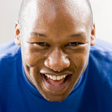 Fatigued man smiling. And dripping sweat stock photography