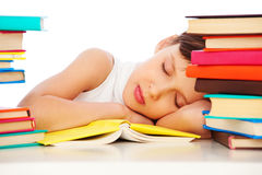 Fatigued schoolgirl sleeping on book. Portrait of fatigued schoolgirl sleeping on book stock photos