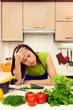 Fatigued woman. In the kitchen stock image