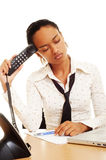 Fatigued woman with telephone Royalty Free Stock Photos