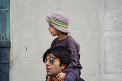 Fatih Akin and son. A nice image of  Fatih Akin and his son upon his shoulders. The image was taken in front of the Excelsior Hotel just few hours before the Stock Photo