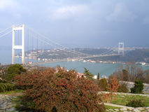 Fatih bridge over Bosporus. Fatih Sultan Mehmet Bridge over Bosporus, in a foggy day. It is a busy pasage  Europe and Asia in Istanbul, Turkey Stock Image