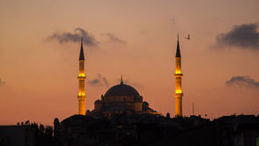 Fatih Camii Conqueror`s Mosque in Istanbul, Turkey. Dusk, Birds fly in silhouettes. Stock Photos