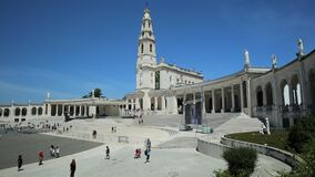 Fatima anniversary apparitions. Fatima, Portugal - August 15, 2017: Tourists, faithful and pilgrims in the square of the Sanctuary of Fatima in Portugal for the stock video footage