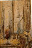Fatima Hand Door Knocker. A rusty Fatima Hand Door Knocker on a weathered wooden door in the village of Tafraoute, Morocco Royalty Free Stock Image