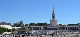 Fatima Portugal. Pilgrims in the big square in front of Fatima Church, one of the most important ones in Europe Royalty Free Stock Photo