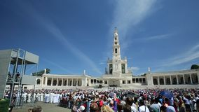 Fatima anniversary apparitions square. Fatima, Portugal - August 15, 2017: square full of tourists in the Sanctuary of Fatima in Portugal for the 100th stock video